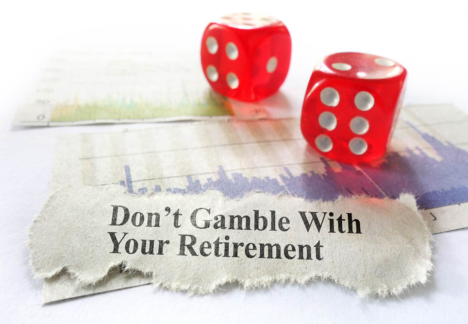a pair of dice on a table with pictures of stock graphs and a quote that says dont gambe with your retirement